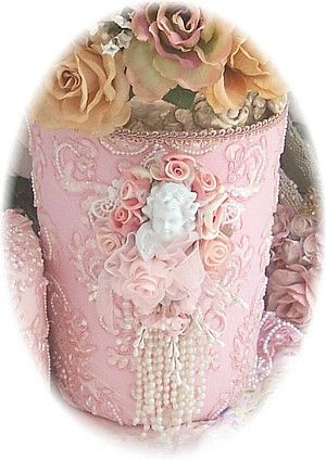 This Victorian Decor Cherub wastebasket is handcrafted covered with luxurious beaded, embroidered lace. Embellished with sweet cherubs, rosettes and decorative tassels. Perfect for your Romantic Victorian or Cottage Chic bedroom or bathroom decor! Embellishments such as beading, florals, lace etc....may vary slightly depending on availability of materials.....however, we promise every item to be as beautiful or more beautiful than shown    This will ship directly from the Romantic Victorian