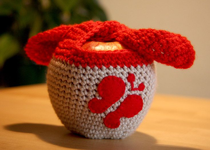 Crochet apple fruit cozy with felted butterfly.