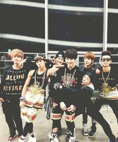 BTS From L to R, V, Jimin, Suga, Jungkook, J-hope (hugging Jungkook), Jin, RapMon