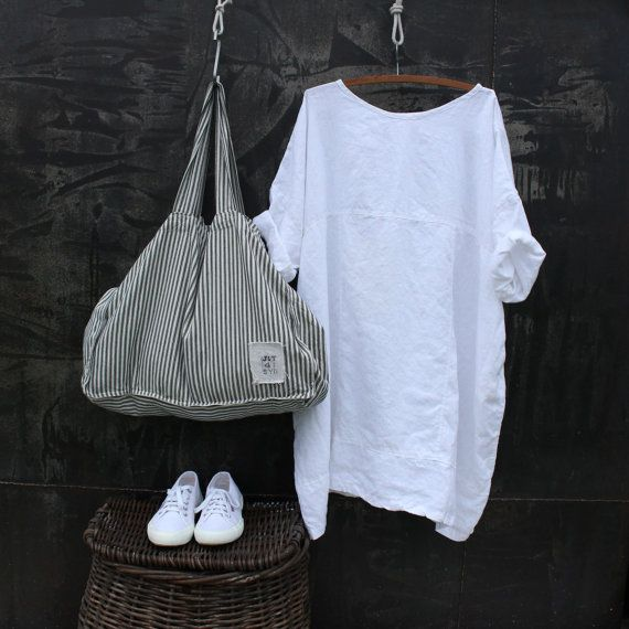 This is a new oversized linen dress, perfect for summer, the bust measurement will seem large but it is intended to drape and looks fabulous. It is made from a medium linen, it has side pockets, short sleeves and double stitching for detail. Please allow two weeks for your order to be shipped.  Measurements Bust 62 inches  Length 38 inches