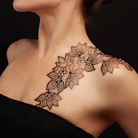 Lace tattoo on collarbone