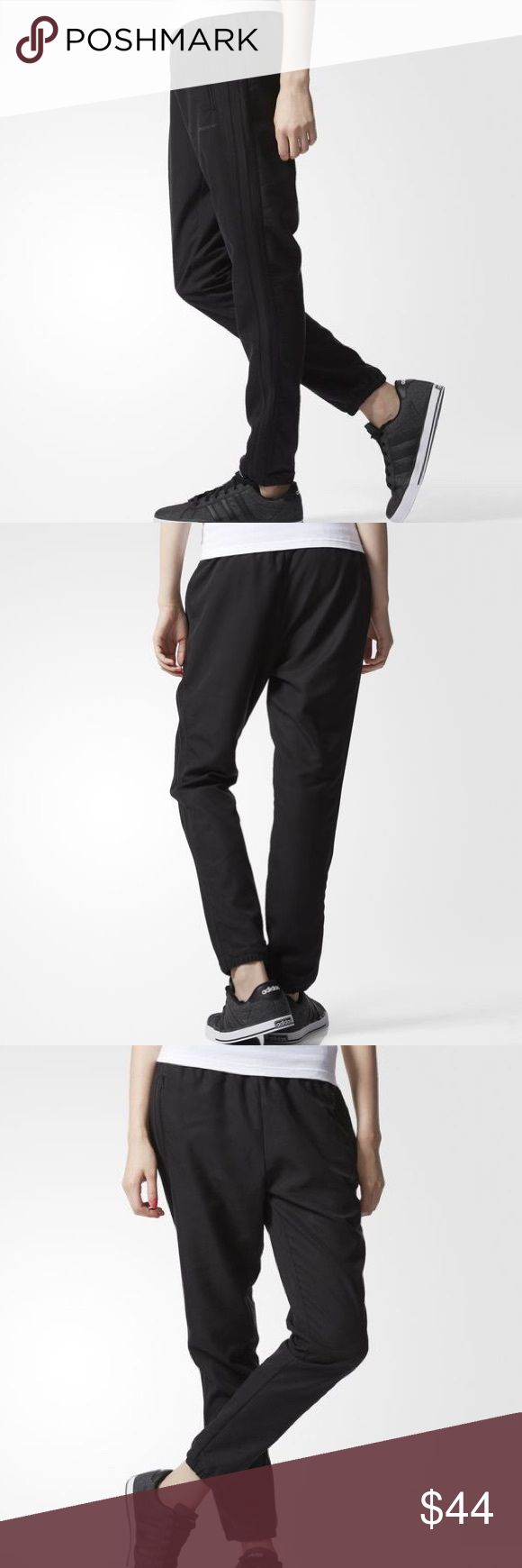"""WOMEN'S ADIDAS NEO TRACK PANTS NO TRADES - 🎈REDUCED 🎈 Simple, sophisticated comfort. These girls' track pants come with a soft build and an easy elastic waist. The clean tapered shape has a relaxed fit and handy front zip pockets. Front zip pockets Internal drawcord on elastic waist Elastic cuffs adidas neo logo below left pocket """"27.5"""""""" inseam (size Med)"""" Relaxed fit; Tapered legs 65% tencel / 35% polyester twill Adidas Pants Track Pants & Joggers"""