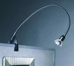 This flexible 20-inch arm, low voltage (12 volts) display light is available in either black or white. This exhibit arm light includes a 50-watt MR16 halogen lamp and a quiet electronic transformer and is ideal for lighting trade show booths, museum exhibits, retail displays, artwork, signs, or wall hangings.