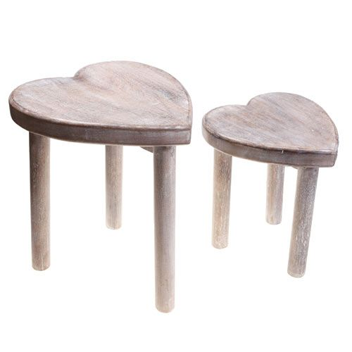 Love-inspired occasional seating for any room. These charming rustic wooden stools have heart-shaped seats.