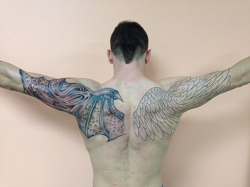 angel demon wings tattoo by Wes Fortier at Fountain of Youth Waterbury, CT