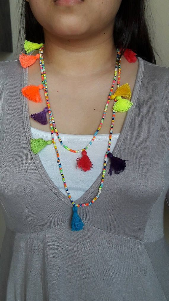 Summer Boho multi tasselled Long Necklace/ Tassel Necklace / Multi coloured necklace/52  Multi tasseled, multi coloured Long neck piece. This light weight long beaded and multi coloured tassel necklace is a perfect summer treat.. Wear it single or doubled wrapped, even can be worn as multi wrapped bracelet(see picture)  Length : Approx.52 inches Colours may appear slightly different in the pictures shown here.  Price for a single necklace  Shipping : We also use Express delivery, please…
