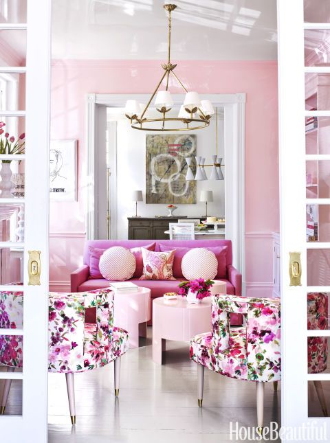 Talk about pretty in pink: The center parlor in this Virginia townhouse is painted in a custom high-gloss pink from Fine Paints of Europe. The sofa in Kravet's Stone Harbor linen heightens the lively mood. Click through for more pink home decor and pink decorating ideas.