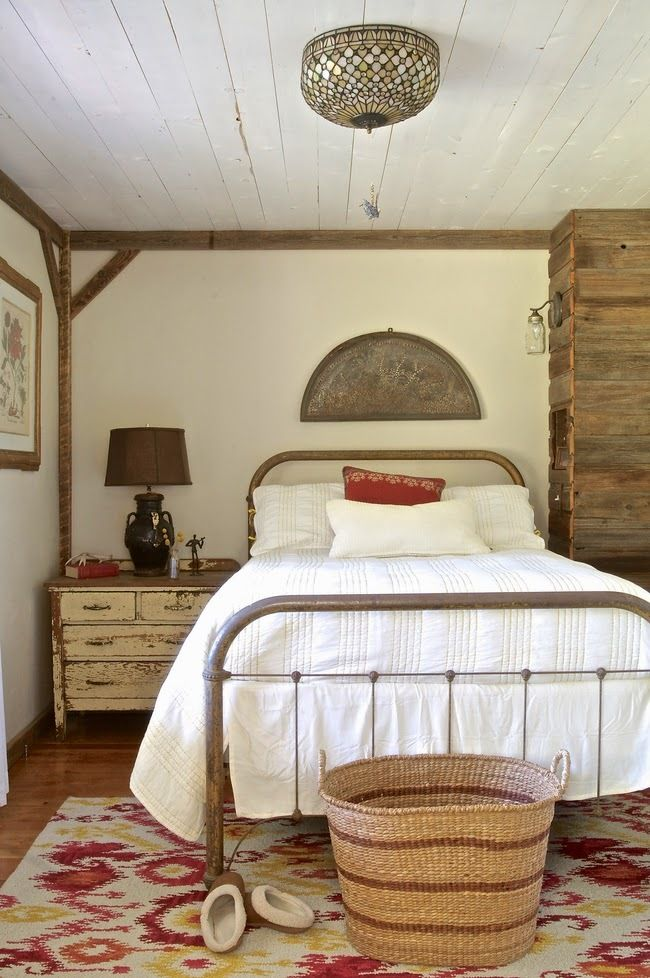rustic guest bedroom inspiration with metal bed frame