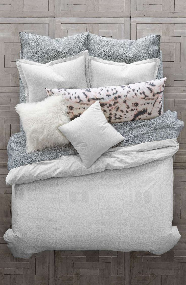 A delicate print inspired by chantilly lace adds to the soft romance of a comforter and sham set in smooth cotton percale.