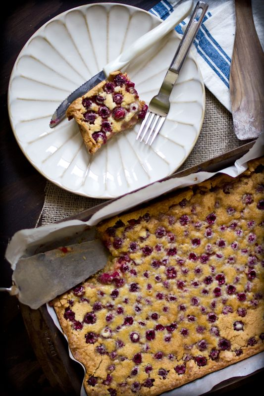 Raspberry custard bars with an almond shortbread crust