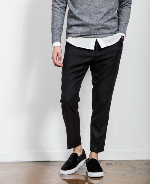 *black slip on sneakers, black slacks, white silk shirt, grey sweater