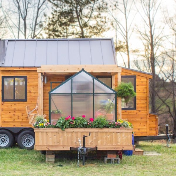 Mobile Tiny Home Comes Equipped with Its Own Detachable Green House.structure measures 323 square feet but still feels bright and airy. Boasting light-colored wood and white walls, the loft-style unit creates the illusion that it's twice as big as it really is. A galley-style kitchen has a fridge and full-size gas stove with shelving above the large sink. Coupled with under-the-stair storage, knickknacks are out of sight and clutter free. To make the space even more flexible, Olive Nest…