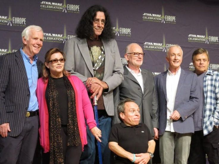 """The original """"Star Wars"""" cast from """"Return of the Jedi"""" gathered 30 years after the film hit theaters in 1983.  Actors Jeremy Bulloch (Boba Fett), Carrie Fisher (Princess Leia), Peter Mayhew (Chewbacca), Warwick Davis (Wicket the Ewok), Ian McDiarmid (Emperor Palpatine), Anthony Daniels (C-3PO), and Mark Hamill (Luke Skywalker) all posed together Thursday at annual fan event Star Wars Celebration in Essen, Germany."""