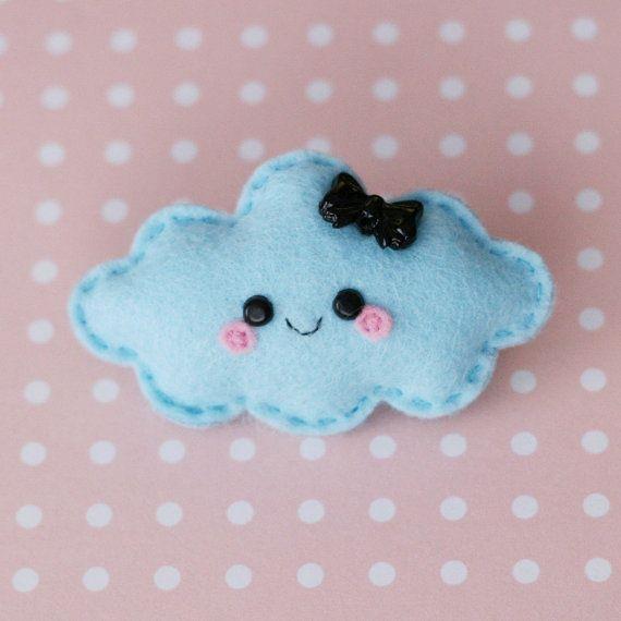 A one of a kind cute blue cloud felt brooch with a pretty black bow wants to be given a nice home and is ready to be worn on your jacket, bag or anywhere youd like! This cloud measures 7cm (3 inches) across ~-~-~-~-~-~-~-~-~-~-~-~-~-~-~-~-~-~-~-~-~-~-~-~-~-~-~-~-~-~-~-~ Each brooch I make takes hours of hand-stitching and is made out of soft felt, this means each one is unique. This brooch is filled with the same material used to fill teddy bears (so you know its squishable and huggable!)...