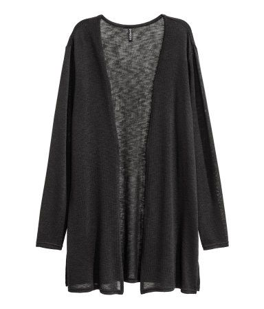 Black. Cardigan in a soft, fine knit with slits in the sides and no buttons.
