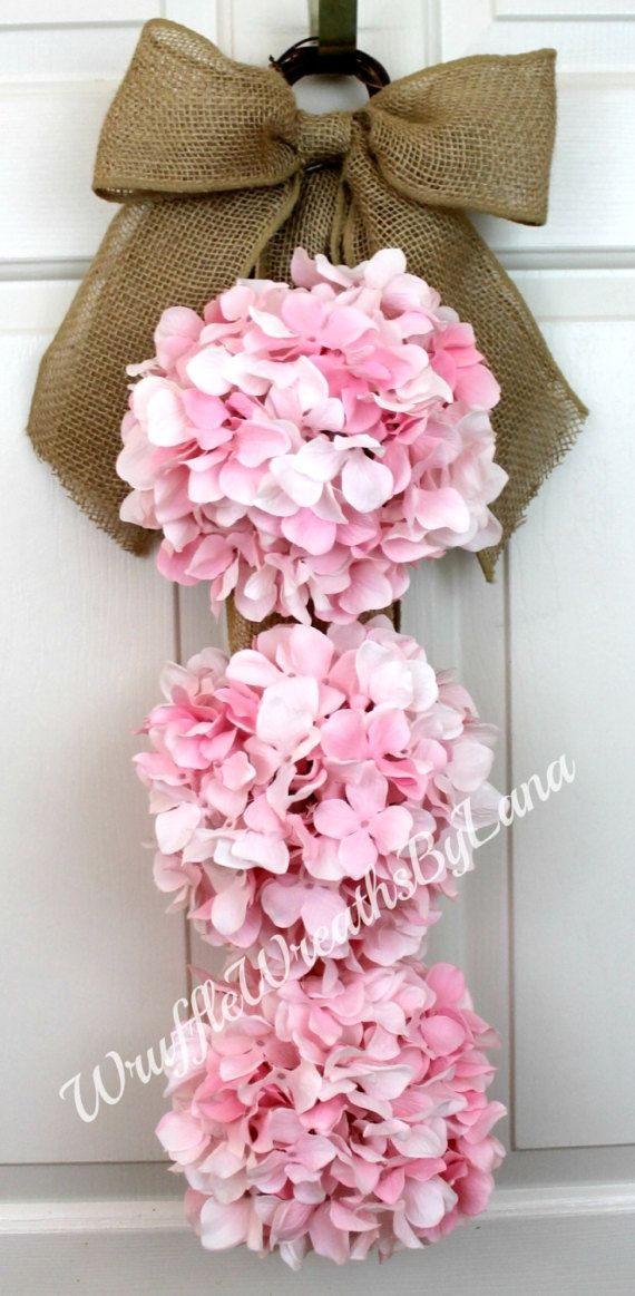 This Pink Hydrangea Swag is so pretty and can be used for so many different occasions. I made this swag using burlap for the hanger and the bow and added three light pink hydrangeas. This swag could be used for a wedding, a bridal shower, a baby shower, given as a gift for Mothers Day, for Easter, or used every day on your front door!  This swag measures approximately 10X36 so its a nice size to fit anywhere youd like to hang it. If you have double doors, just let me know, and Ill be glad to…