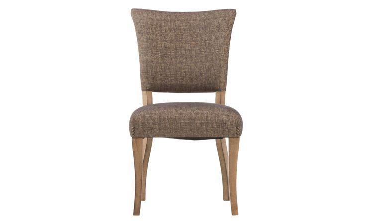 The Epicenters Williamsburg Upholstered Side Chair is a stunning dining room option. The neutral upholstered back and seat offers comfortable seating that's stylish. Completed in a reclaimed finish for an edgy loft look!