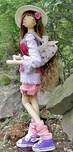 Love the cute doll.