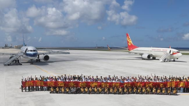 A pair of Chinese civilian jet airliners landed at an airfield on the newly created Fiery Cross Reef in the Spratly Islands to see whether it was up to standard. It is China's largest man-made island. Picture: Xing Guangli/Xinhua via AP.