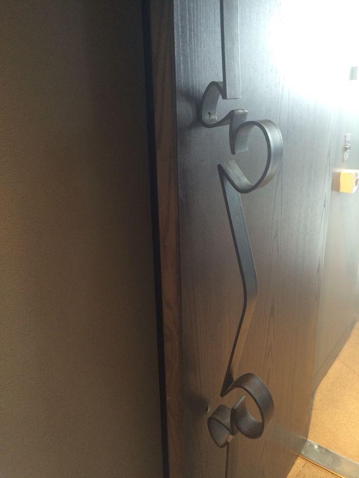 Decorative metal curvy door handle