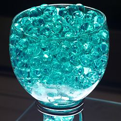 Clean water beads with a blue (not turquoise) led light and yellow gerbera daises for center pieces?