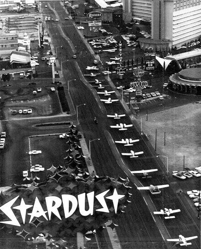 "From the AP: September 25, 1968 -""Taxiing down 'The Strip'. Thirty four planes with a police escort took over the Las Vegas Strip early Tuesday on the way from the airport to the Riviera Hotel. The Aircraft Owners and Pilots Association is holding a convention in Las Vegas and the planes were parked at the hotel parking lot for display before sale."""