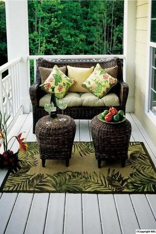 Tropical Porch with Wrap around porch, Porch swing, Sure Fit Wicker Patio Loveseat