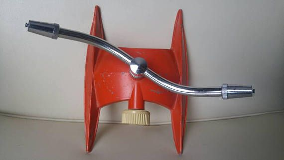 Everain lawn Sprinkler , red rocket , mid century modern style , metal , untested , made in USA Check out this item in my Etsy shop https://www.etsy.com/ca/listing/568153488/everain-lawn-sprinkler-red-rocket-mid #lawncare #vintage #sprinkler #etsyshop #vintageshop #everain #midcenturydecor Check out this item in my Etsy shop https://www.etsy.com/ca/listing/568153488/everain-lawn-sprinkler-red-rocket-mid