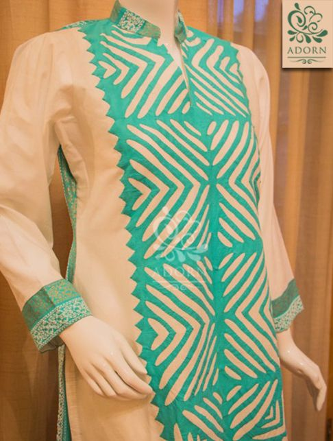 Cream with turquoise rilli on the neckline. https://www.facebook.com/ADORN.Online/