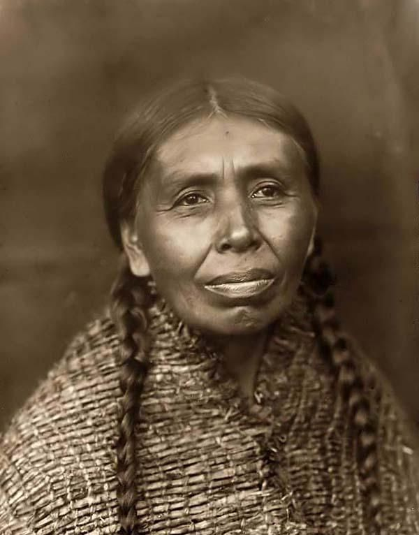 You are viewing a rare image of Lotsubelo. It was taken in 1913 by Edward S. Curtis.    The image shows Quilcene woman, head-and-shoulders portrait, facing front.