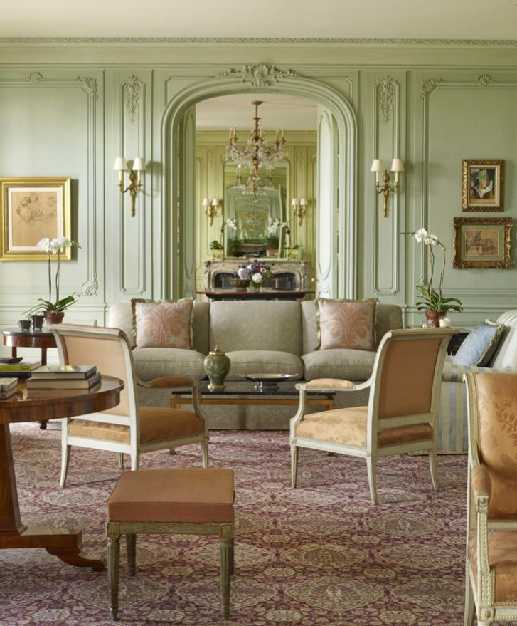 In A Living Room With Walls Paneled In A Cool Mint Green, Thomas Jayne Used