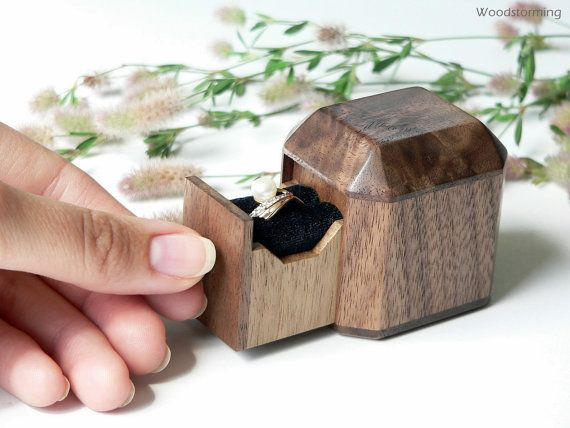 We created this unique engagement ring box to present your engagement ring in a special way. It will safely hold your ring till that moment and after and will be great gift and family keepsake forever.  * * * This box is MADE TO ORDER. We can make it in 5-7 business days after your order. Wood pattern will not be exactly the same, but we will do our best.  Box size will be about: L 5 x W 4,3 x H 5,1 cm  The box is made of walnut and finished with ecological oil and wax to reveal natural…