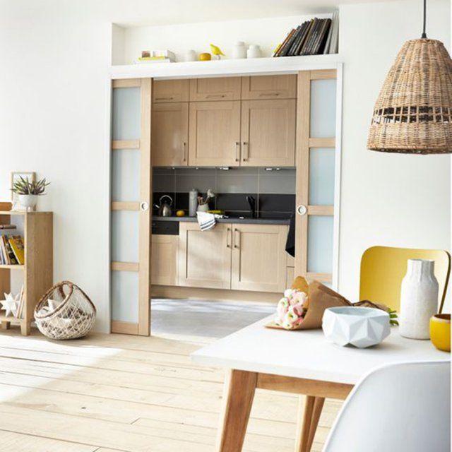 Une cuisine ouverte par une grande porte coulissante cuisine - Grande porte coulissante ...
