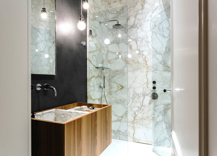 Located in a nice residential area in Milan, the apartment is part of an elegant and well designed 1920's complex.  #nomadearchitettura #design #interiors #interiordesign #italiandesign #italianstyle #luxury #milaninteriors #decor #marbles #glasslights #pendantlight #luxurylife #SimoneFuriosi