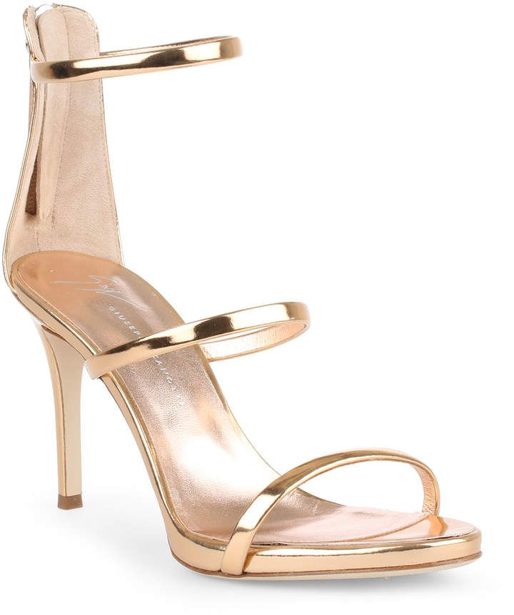 ef2f2251236a Rose gold metallic  leather  sandals from Giuseppe Zanotti. The Harmony is  a signature Zanotti design with three straps