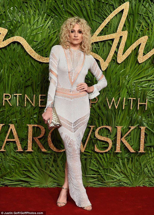 Stealing the spotlight: Dressed in a plunging crochet silver dress, the 26-year-old oozed ...