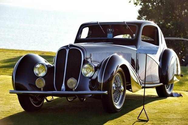 1936 Delahaye from Paris auto salon with Joseph Figoni's sweeping fenders, inspired by the Arc en Ciel aircraft, made the coach-built vehicle. One of three surviving short-wheelbase teardrop coupes, the featured car was selected best-in-show at the 2014 Cobble Beach concours. (CIAS)