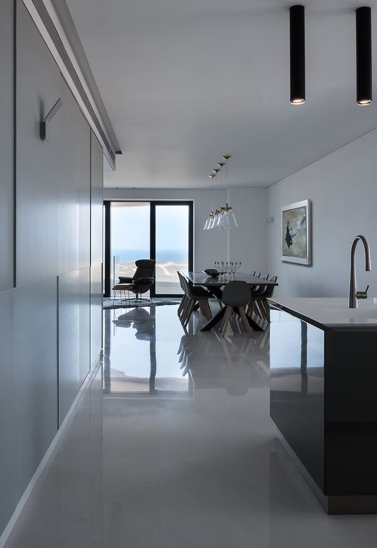 This apartment by Michal Han Interior Design faces Tel Aviv's beautiful seafront. The planning process was both unique and challenging as a result of its semi-circular shape #openspace
