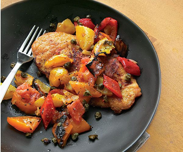 Broiled peppers, tomatoes, and onions become a luscious topping for quickly sautéed chicken breast cutlets. The fried caper garnish adds a crisp, salty note.