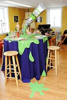 arty party decoration - paint tube spilling paint tablecloth