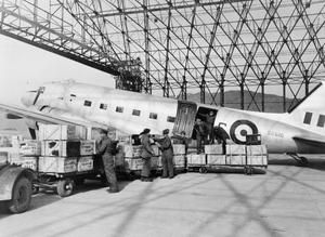 """THE KOREAN WAR 1950 - 1953 part of """"CENTRAL OFFICE OF INFORMATION KOREAN WAR OFFICIAL COLLECTION"""" (photographs)  MH 32095  In their move to Korea, No.2 Squadron, South African Air Force, were assisted by personnel of the Royal Hellenic Air Force. The photo shows boxes of equipment being offloaded from a Douglas C-47 aircraft of the Royal Hellenic Air Force by South African..."""