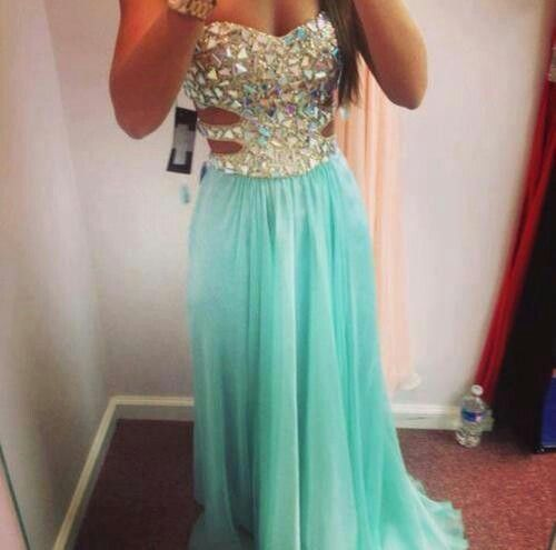 I like this dress I just wish that there weren't the slits in the dress