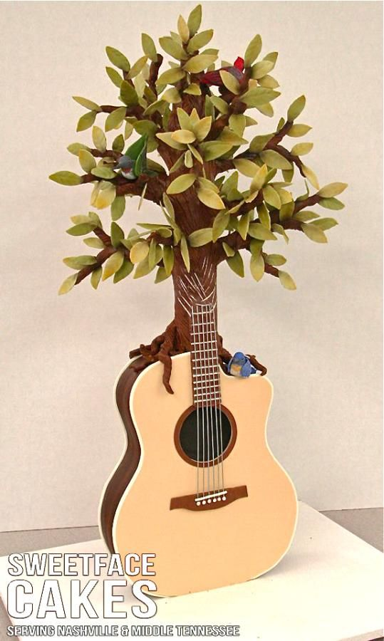 Guitar-Tree Cake. Had to pin this for my hubby...he plays classical guitar :)