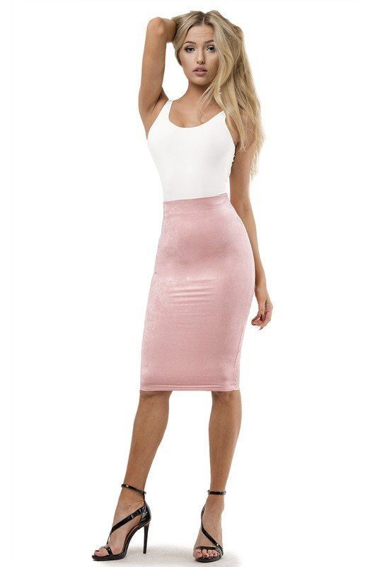Our new Lux Scenester skirt features a faux suede material, comes with lining and is at calf length. Perfect to wear with one of our classic bodysuits. POLYESTER, SPANDEX Made in USA