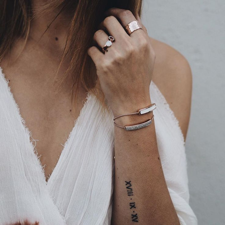 small arm tattoo, roman numerals wedding date, rose gold jewellery