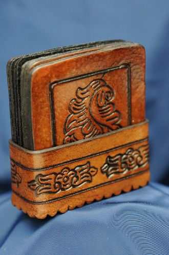 This is a beautiful southwest or western leather 8 piece coaster set. This…