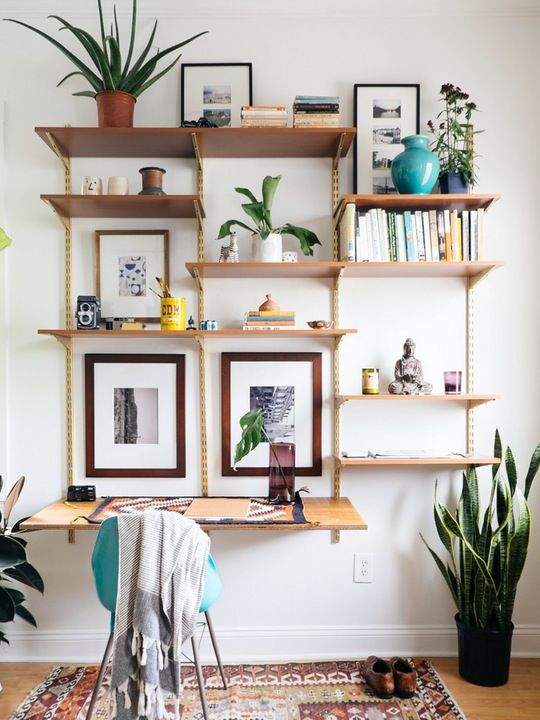 Wall-Mounted Shelving Systems You Can DIY ** I like this for shelving but it would also work as a sitting/standing desk I think!! Just have 2 different levels :)
