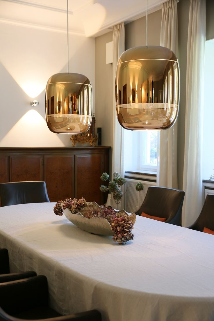 Blown Glass Suspension Fixtures In Metalized Finish Illuminate The Dining Room Of A Private Residence Germany