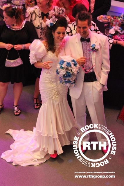 Another look at the best 1980s wedding dress and groom's suit ever. Did we mention this wedding reception was at The Rock and Roll Hall of Fame?