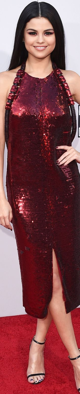 Selena Gomez wearing a red sequin Givenchy dress paired with Jimmy Choo shoes  2015 AMA's